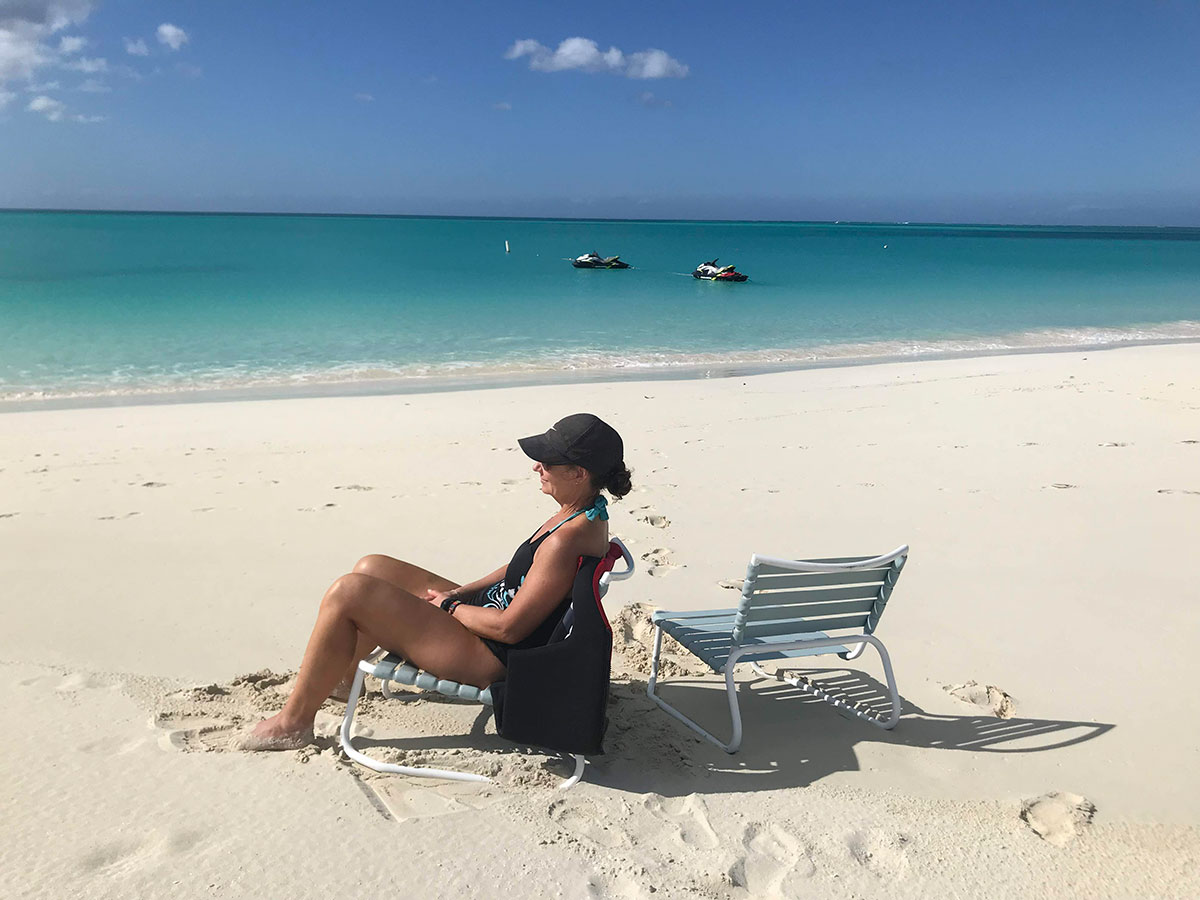 feet in white sand of TCI