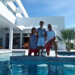 "alt=""A family in front of Turks and Caicos villa rentals"
